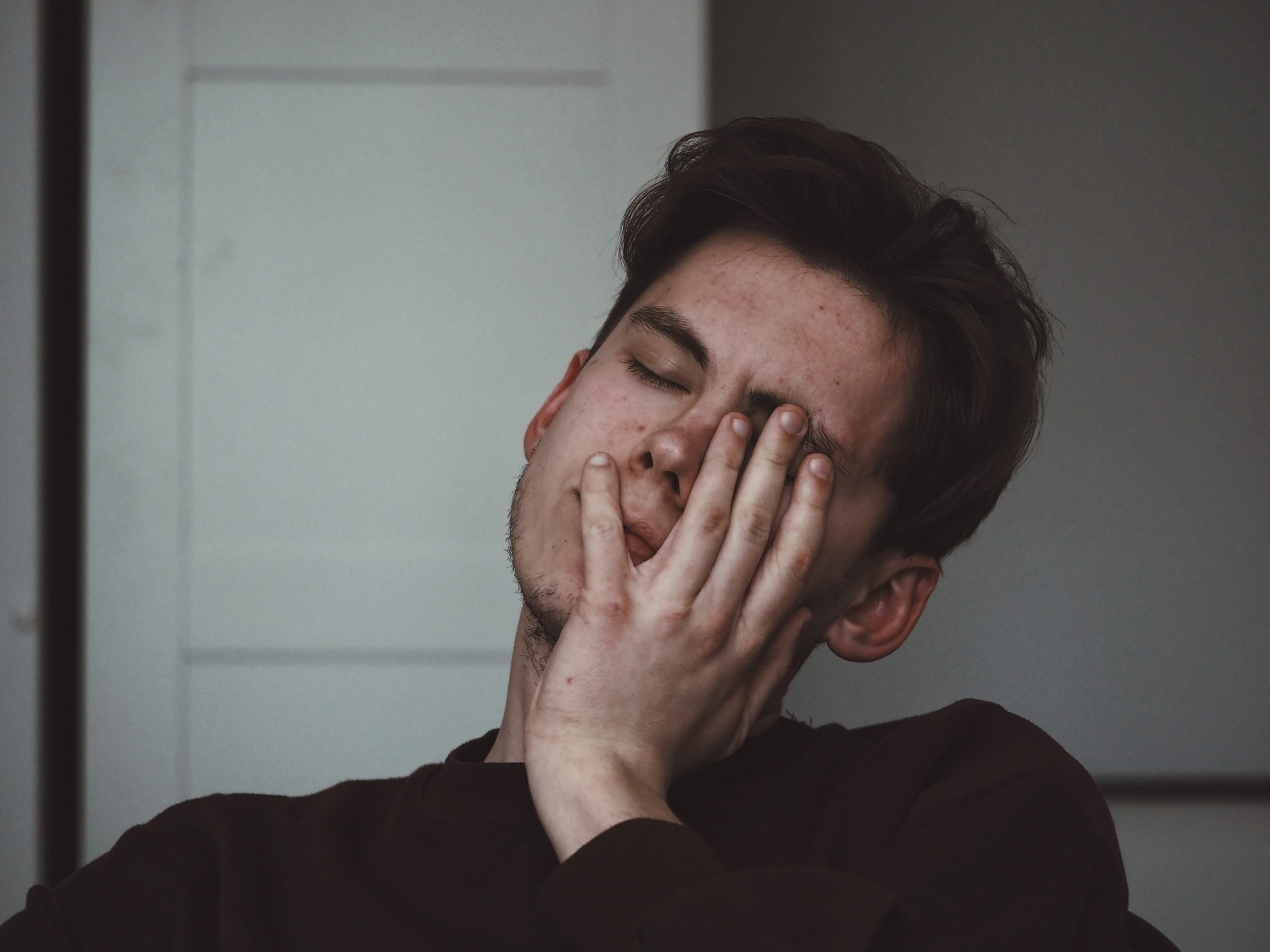 A man experiencing brain fog due to lack of sleep.